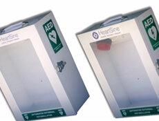Image displaying two closed Automated External Defibrillator Cabinets next to eachother.