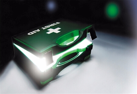 Image displaying an open Green First Aid Kit Box with a bright light emerging from inside.
