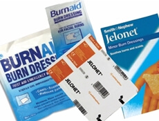 Image displaying various packets of burn dressings and paraffin gauze's.