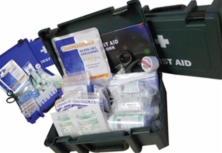 Image displaying multiple Economy First Aid Kits and their contents.