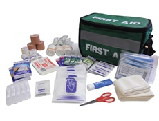 Image showing a Large Sports First Aid Kit Haversack with all of the Kit's contents emptied out in-front.